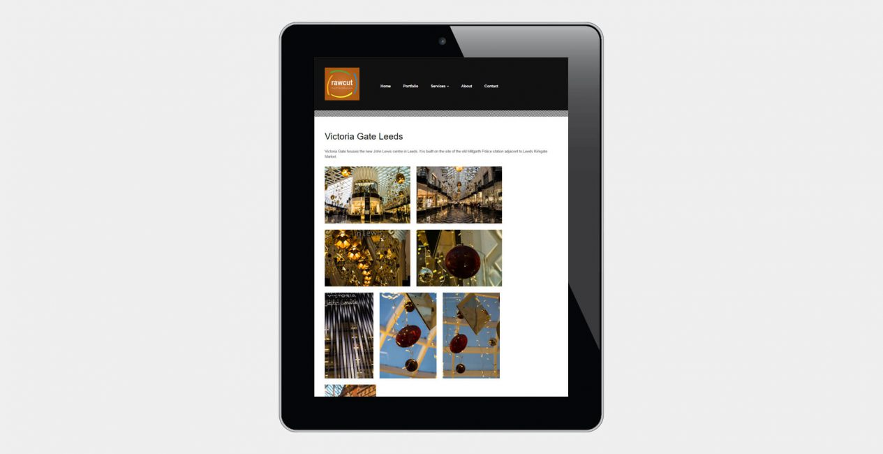 A tablet displaying the rawcut photography website designed by Green Route Media.